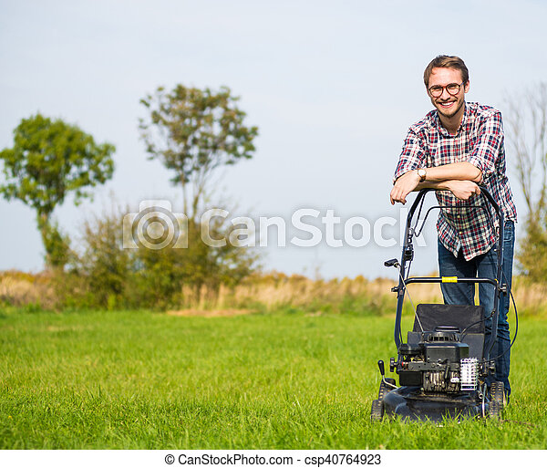 Young man mowing the grass - csp40764923