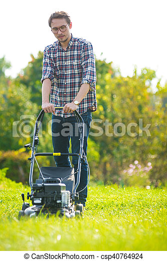 Young man mowing the grass - csp40764924