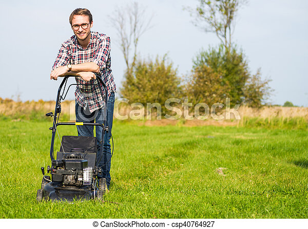 Young man mowing the grass - csp40764927
