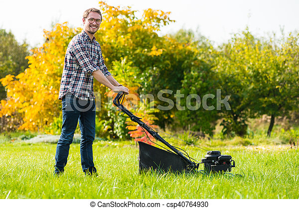 Young man mowing the grass - csp40764930