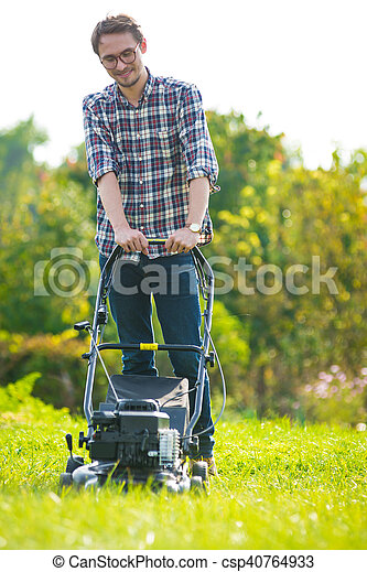 Young man mowing the grass - csp40764933
