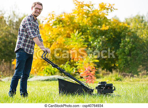 Young man mowing the grass - csp40764934