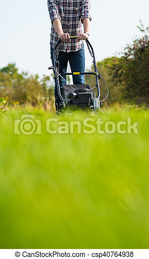 Young man mowing the grass - csp40764938
