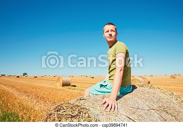 Young man on the cornfield - csp39894741