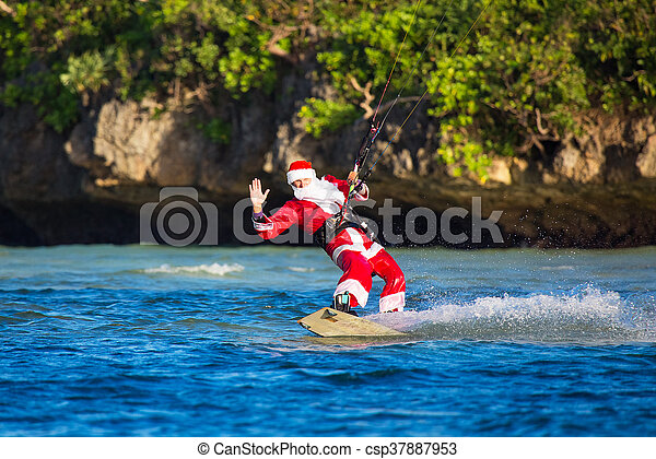 Young Man On The Kite In The Costume Of Santa Claus Christmas And