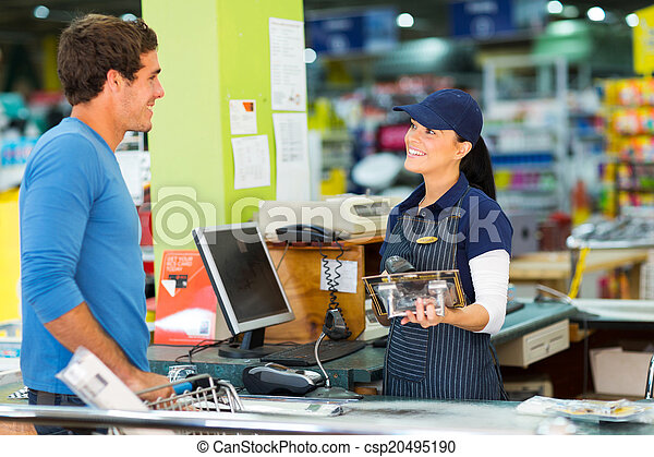 young man paying at till point in hardware store - csp20495190