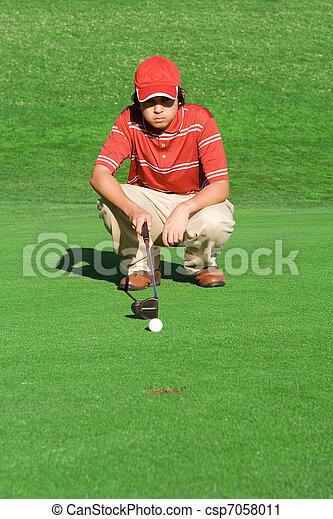 young man playing golf calculating shot - csp7058011