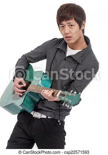 young man playing guita - csp22571593