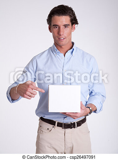 Young man pointing at box - csp26497091