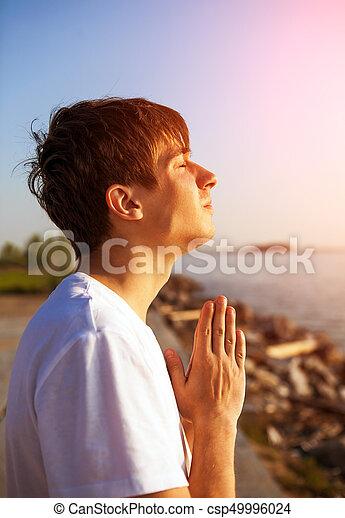 Young Man praying - csp49996024