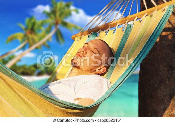 young man relaxing hanging chair - csp28522151
