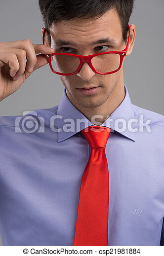 4b93e46dd10 Young Man Removing Glasses On Grey Background. Handsome Guy Wearing Red  Necktie