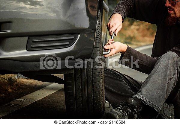 Young man repairing car - csp12118524