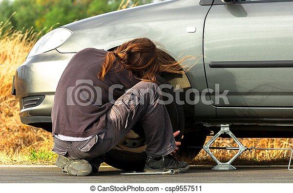 Young man repairing the car - csp9557511
