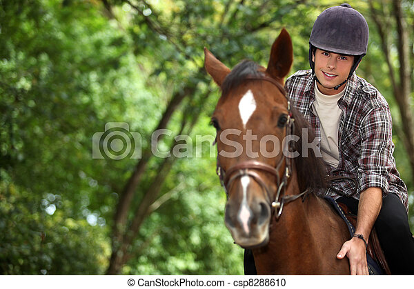 Young man riding horse - csp8288610