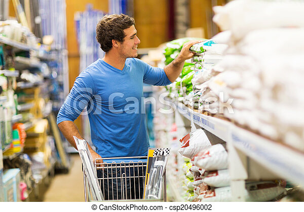 young man shopping in hardware store - csp20496002