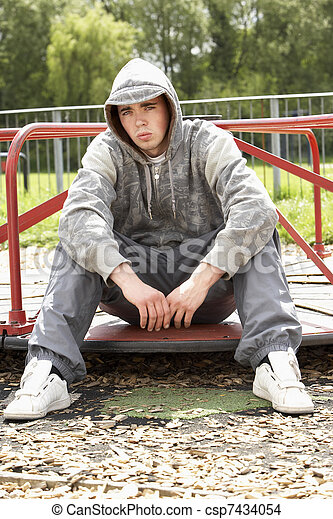Young Man Sitting In Playground - csp7434054
