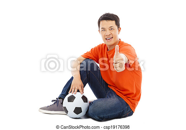 young man sitting with a soccer and thumb up - csp19176398
