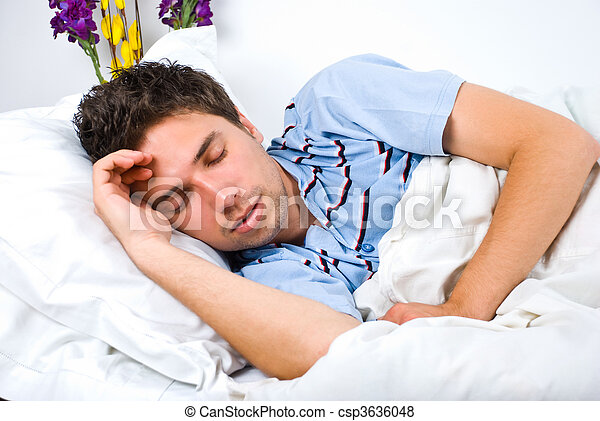 Young man sleeping in bed - csp3636048