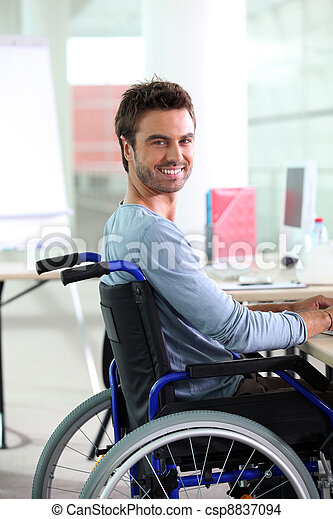 Young man smiling in wheelchair - csp8837094