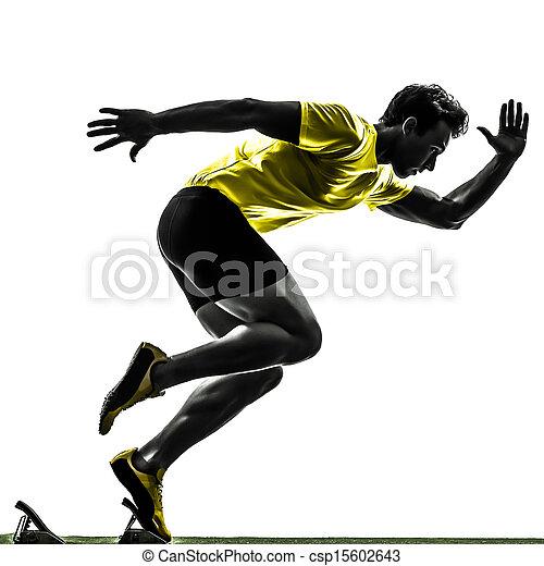 young man sprinter runner in starting blocks silhouette - csp15602643