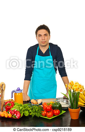 Young man standing in kitchen - csp9218189