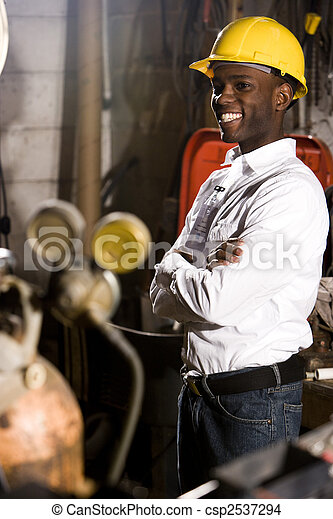 Young man standing in office maintenance room - csp2537294