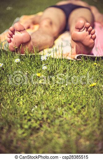Young man sunbathing - csp28385515