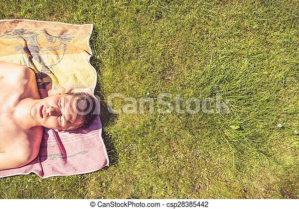 Young man sunbathing - csp28385442