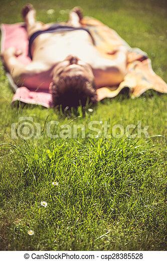 Young man sunbathing - csp28385528