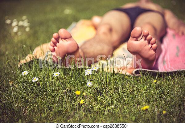 Young man sunbathing - csp28385501