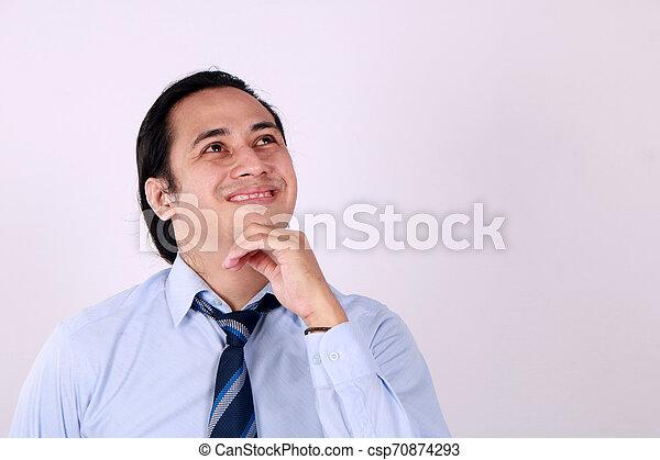 Young Man Thinking and Looking Up, Having Good Idea - csp70874293