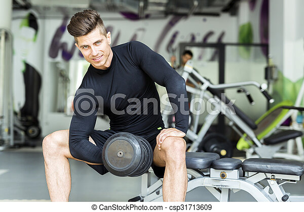 Young man training in a gym - csp31713609