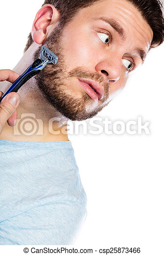 Young man with beard holding razor blade - csp25873466