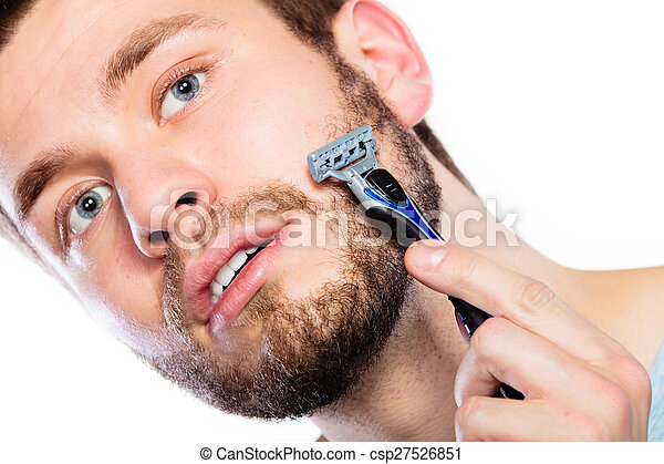 Young man with beard holding razor blade - csp27526851