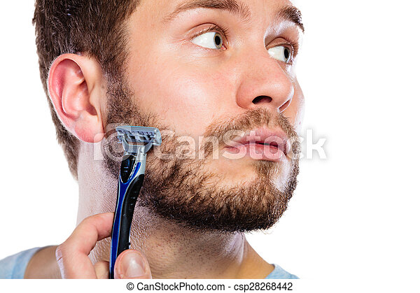 Young man with beard holding razor blade - csp28268442