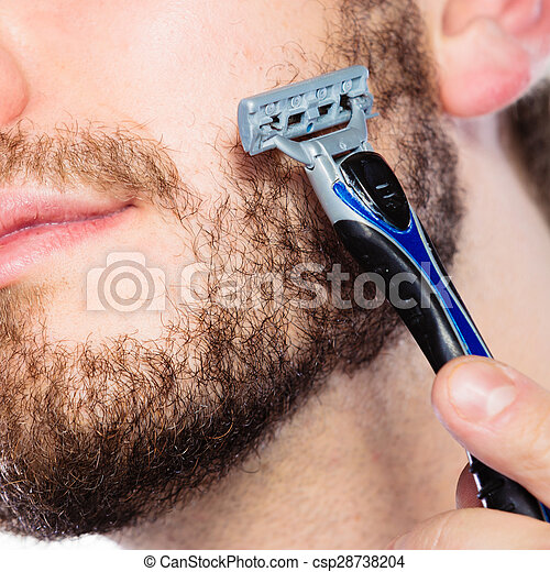 Young man with beard holding razor blade - csp28738204