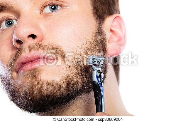 Young man with beard holding razor blade - csp30689204