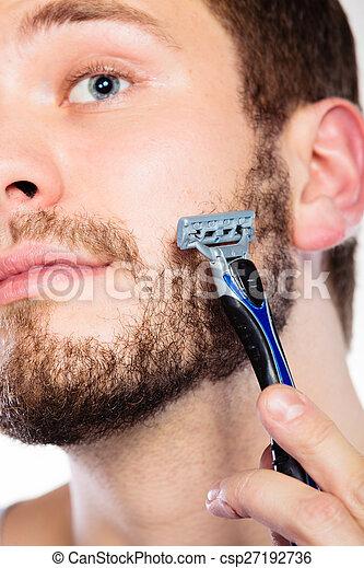 Young man with beard holding razor blade - csp27192736