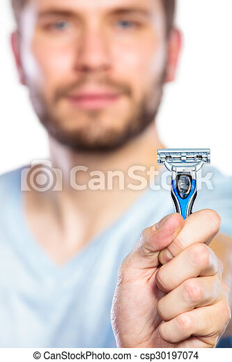 Young man with beard showing razor blade - csp30197074