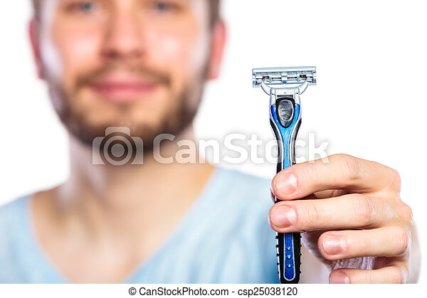 Young man with beard showing razor blade - csp25038120
