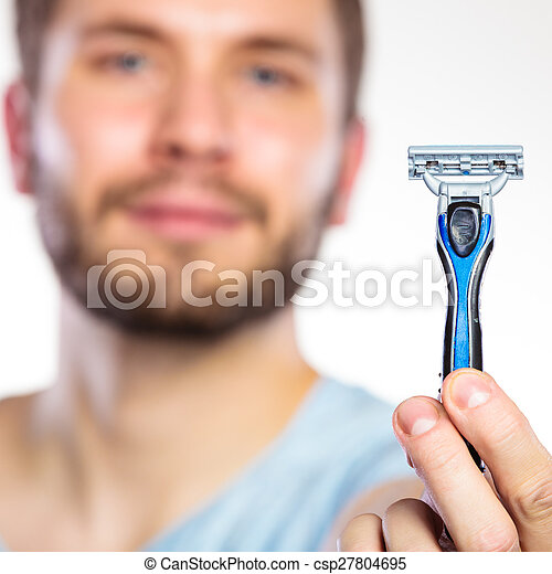Young man with beard showing razor blade - csp27804695
