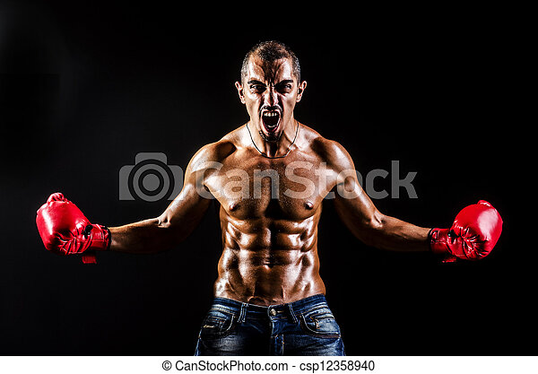 Young man with boxing gloves - csp12358940