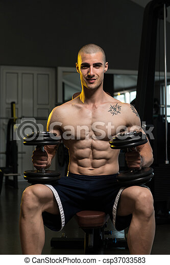 Young Man With Dumbbells Resting Time - csp37033583