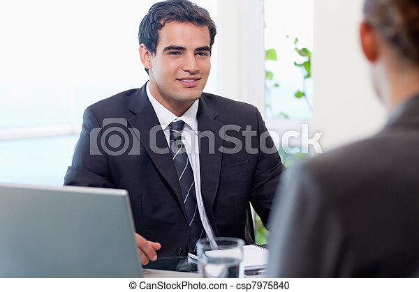 Young manager interviewing a female applicant - csp7975840