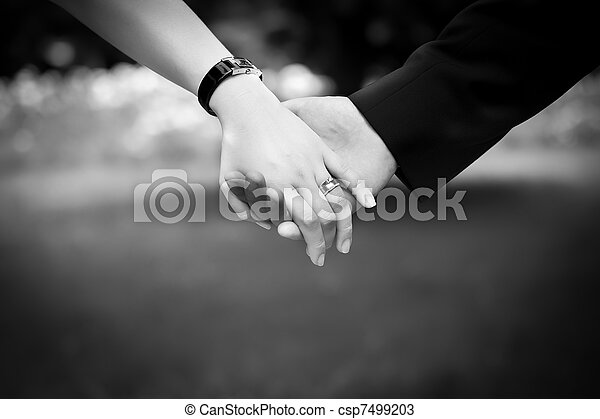 Young married couple holding hands, ceremony wedding day - csp7499203