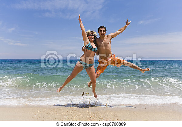 Young men jump on seacoast - csp0700809