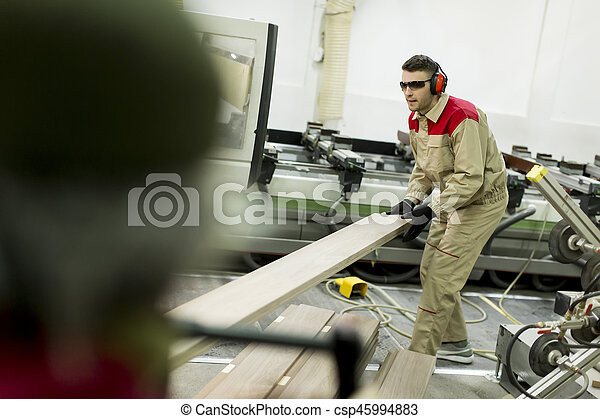 Young men working in furniture factory - csp45994883