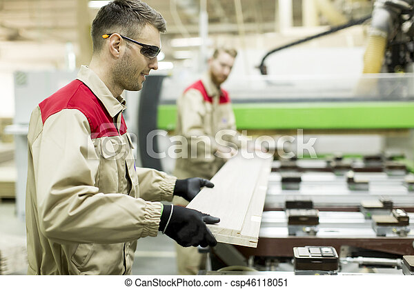 Young men working in furniture factory - csp46118051