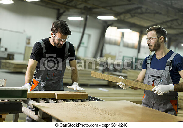Young men working in lumber workshop - csp43814246